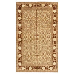 Small Brown and Ivory Antique Indian Agra Rug. Size: 4 ft x 6 ft 8 in