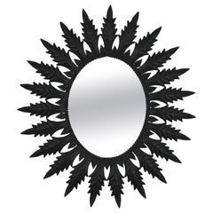 Spanish Sunburst Oval Mirror in Black Painted Metal, 1960s
