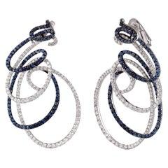 Studio Rêves Spiral Blue Sapphire and Diamond Dangling Earrings in 18 Karat Gold