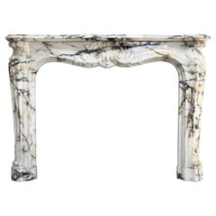 Very Exclusive and Antique Mantel Piece of Paonazzo Marble from 1820, Louis XV