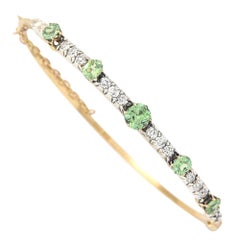 Victorian 18 Karat Yellow Gold Peridot and 1.05ct Diamond Bangle, circa 1880