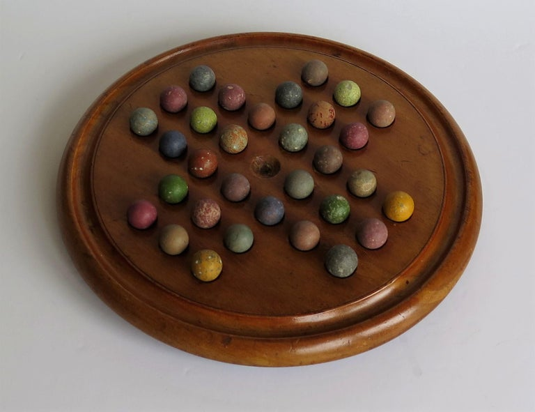 English Victorian Marble Solitaire Game with Mahogany Board and 32 Handmade Marbles For Sale