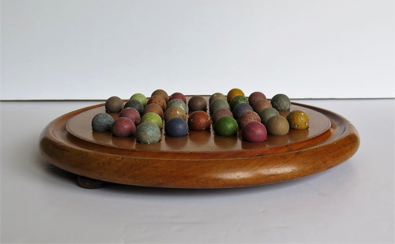 Stone Victorian Marble Solitaire Game with Mahogany Board and 32 Handmade Marbles For Sale