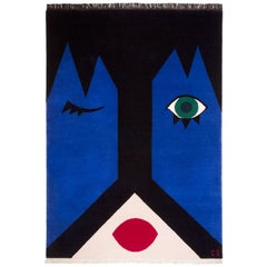 Wool rug with graphic blue red white face by Cecilia Setterdahl for Carpets CC
