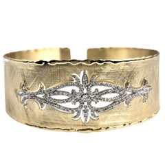 Yellow and White Gold Rustic Bangle with .83 Carat Diamond Accent by DiamondTown