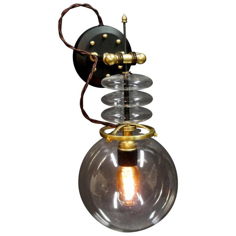 "Art Donovan ""Tesla Wall Light"" Globe Glass, Brass, Maple. Black and Gold. 1"