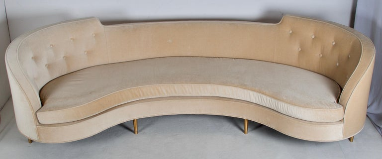 Wonderful and stylish sofa from the midcentury period. The sofa sit's deep, it is upholstered in mohair, legs are patinated brass. There is some soiling to the fabric however it is not offensive. Measures: Arm height 31