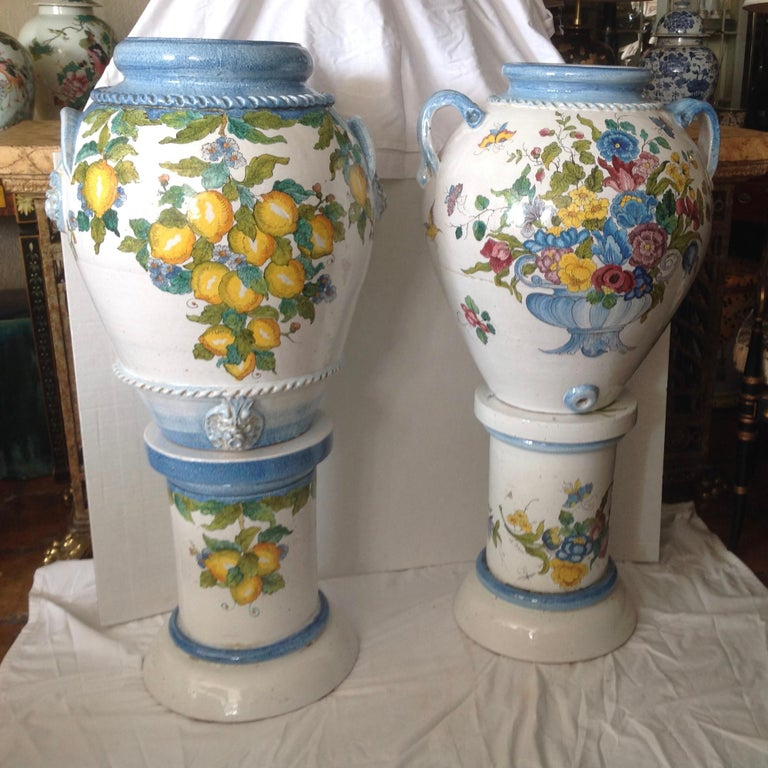 Dramatic in scale: Hand painted urns - superbly fashioned in the Tuscan style - 