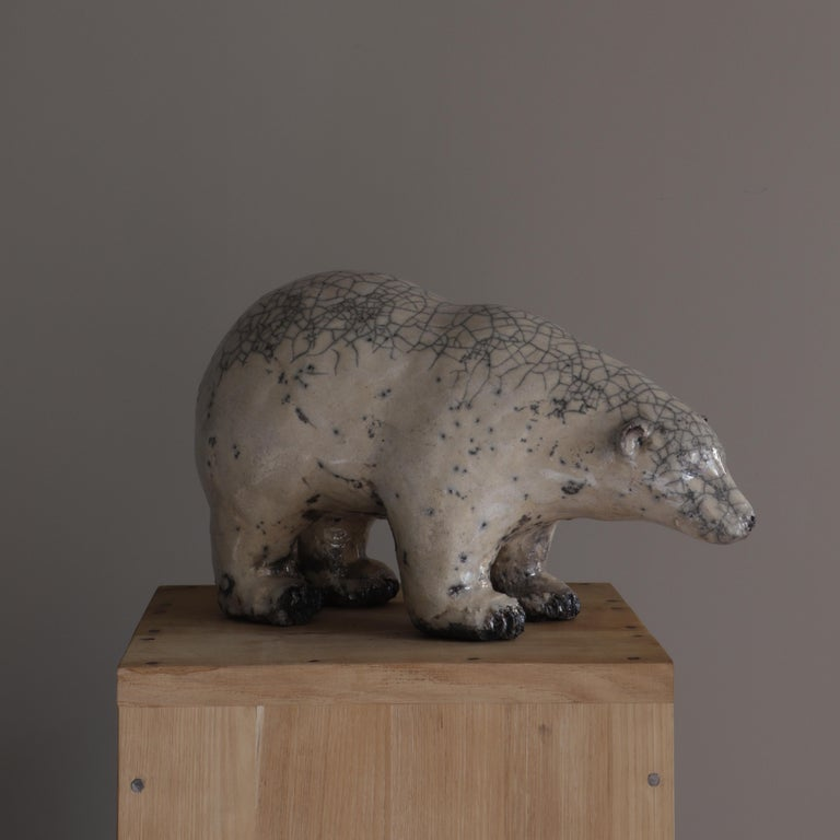 Joanna Hair created this Bear using the Raku technique consisting of smoking the piece in wood chips or sawdust, giving it this cracked aspect.
