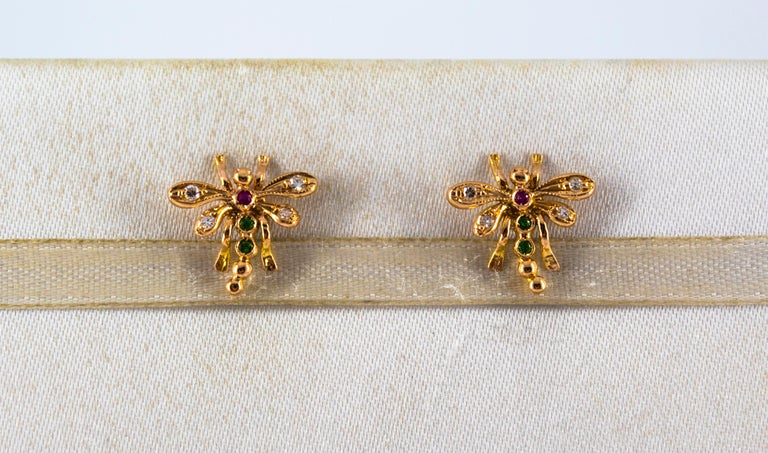 These Stud Earrings are made of 14K Yellow Gold. These Earrings have 0.08 Carats of White Diamonds. These Earrings have 0.04 Carats of Emeralds. These Earrings have 0.02 Carats of Rubies. These Earrings are available also with Blue Sapphires. All
