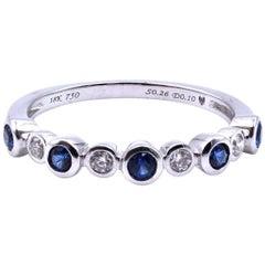 0.10 Carat Diamond and Sapphire 18 Karat White Gold Band