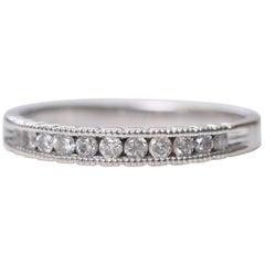 0.15 Carat Diamond and 14 Karat White Gold Eternity Band Ring