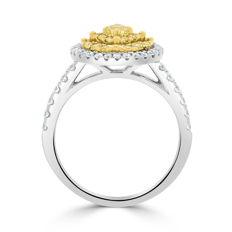 Specially crafted for a mesmerizing finish, this 14k two-tone ring is a luxurious piece to cherish. 14k two-tone gold and noteworthy yellow Diamond amidst white Diamond accents come together in perfect unison to form this Ring. A must-have!