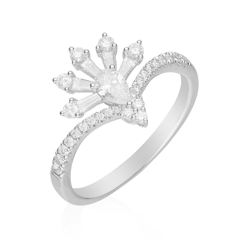 This beautiful Cocktail ring is crafted in 14-karat White gold and features a Pear cut Diamond 0.19 Carat, 5 Baguette Diamonds 0.15 Carat & 28 Round brilliant cut Diamonds 0.25 carat in a prong-setting. This ring comes in Size 7 and it is a perfect