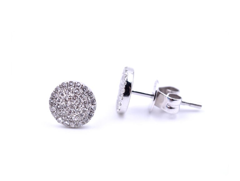 Designer: custom design Material: 14k white gold Diamonds: 76 round brilliant cut = .40cttw Color: G Clarity: VS Dimensions: each cluster stud is 6.73mm in diameter Fastenings: friction backs Weight: 1.70 grams