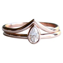 0.20 Carat Diamond Teardrop Ring Stacked with Chevron Rose Gold Ring
