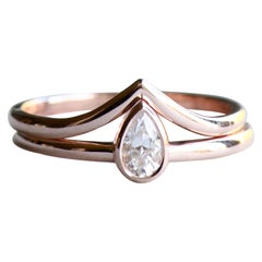 0.20 Carat Diamond Teardrop Ring Stacked with Chevron Rose Gold Ring