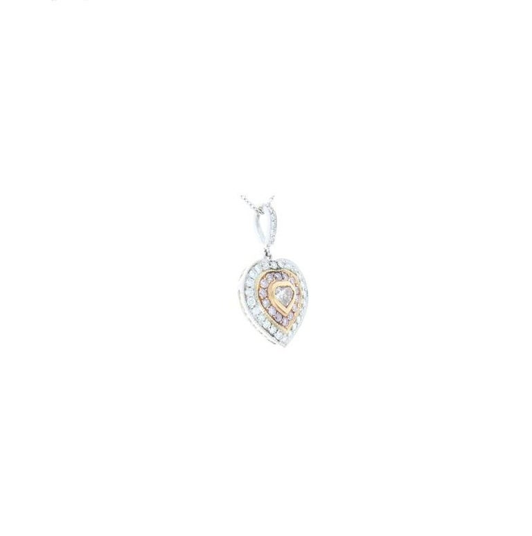 This is an 18 karat white and pink gold dazzling diamond pendant. It features a 0.22 carat natural pink heart-shaped diamond from Australia in the center, framed by a rose gold thin bezel. The pink diamond heart is surrounded by not one, but two