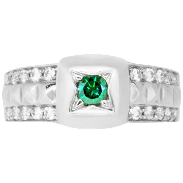 3017f634e 0.20 Carat Round Blue Diamond and 0.39 Carat White Diamond Ring For Sale