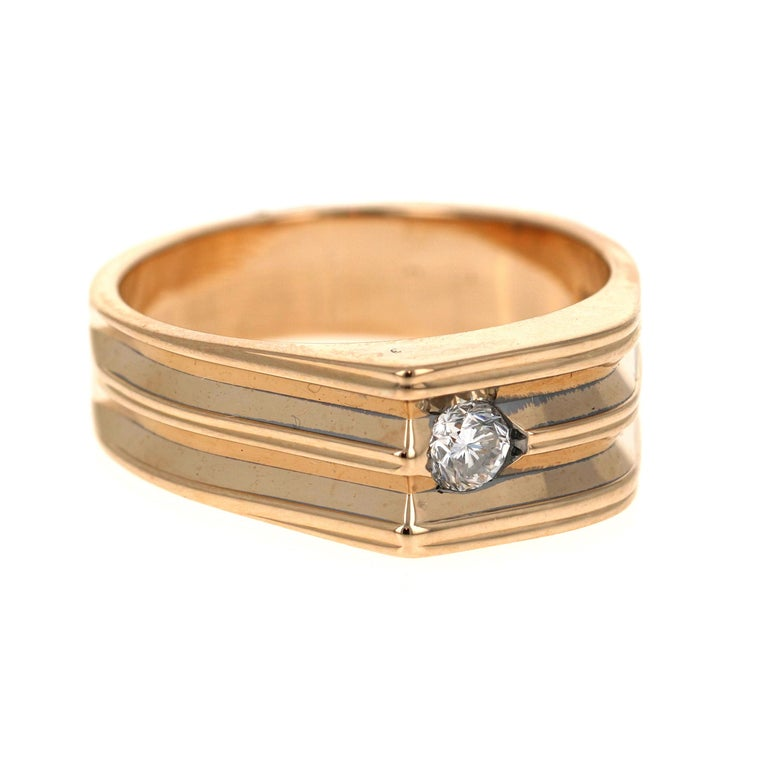 We have a Men's Collection of Fine Jewelry!  Beautiful, Bold, Masculine and Simple Men's Wedding Rings/Bands.   This Men's Band has 1 Round Cut Diamond that weigh 0.20 Carats.  The Clarity and Color of the Diamonds is VS-I.  It is crafted in 14