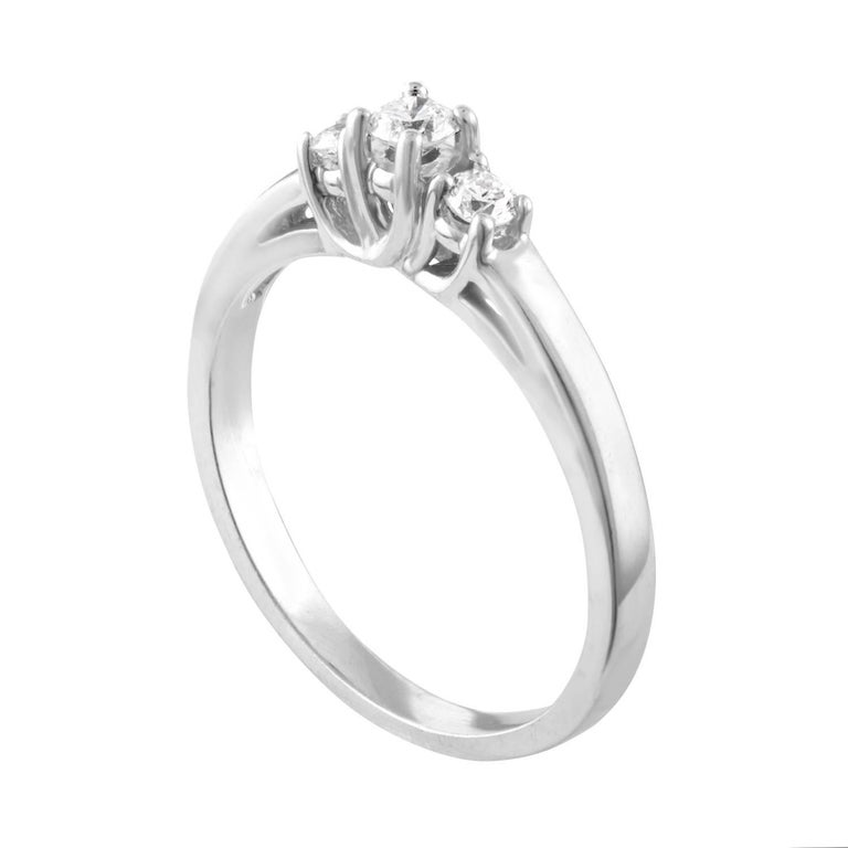 Delicate Three-Stone Ring Great For Stacking The ring is 14K White Gold There are 0.20 Carats in Diamonds H I3 The ring is a size 6.5, sizable The ring weighs 2.5 grams