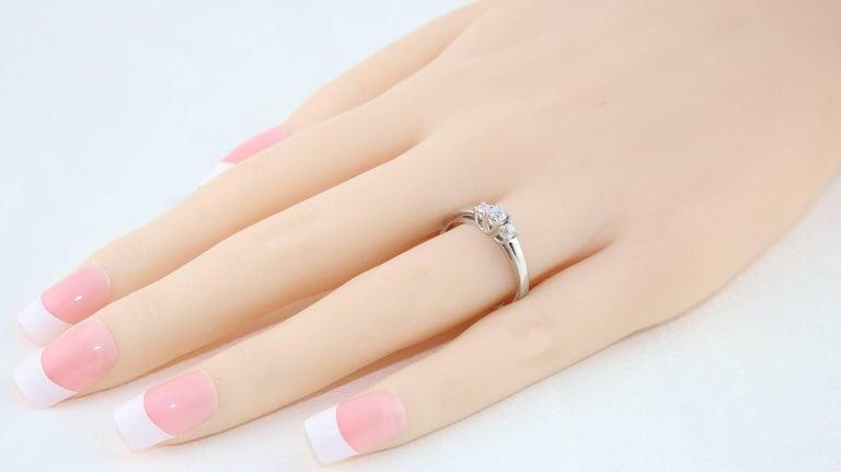 Round Cut 0.20 Carat Diamond Three Stone Gold Ring For Sale
