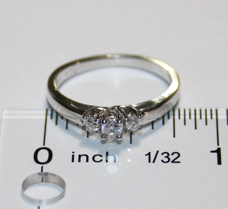 Women's 0.20 Carat Diamond Three Stone Gold Ring For Sale