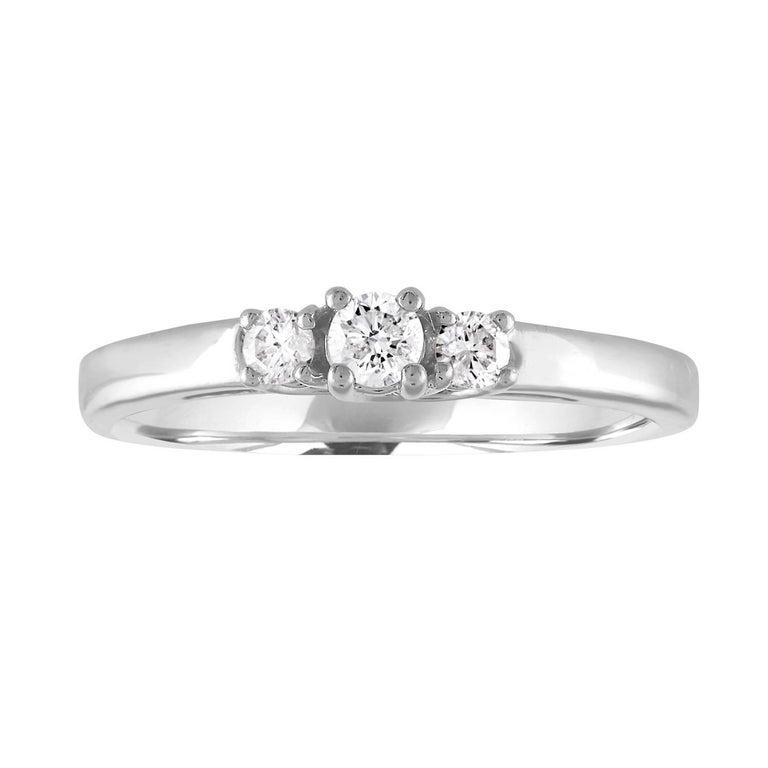 0.20 Carat Diamond Three Stone Gold Ring For Sale