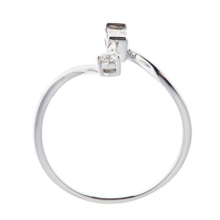 Featuring our Gin and Grace Diamond ring crafted of 14k white gold, this jewelry is the ideal way to showcase your bold style.  This ring features an 1  Baguette Diamond 0.17 carat and 1 Round glistening diamond in GH SI quality 0.07 carat with a
