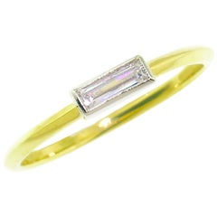 0.25 Carat Baguette Cut Diamond in Platinum and 18 Karat Ring
