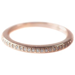 0.25 Carat Diamond and 14 Karat Rose Gold Eternity Band
