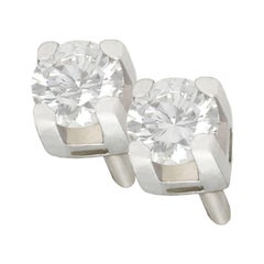 0.25 Carat Diamond and 18 Karat White Gold Stud Earrings, Vintage, circa 1990