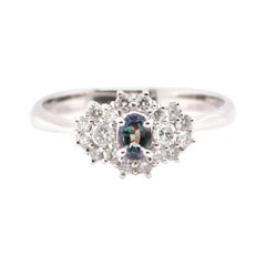 0.25 Carat, Natural Color-Changing Alexandrite and Diamond Ring Set in Platinum