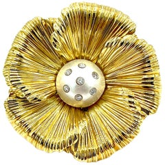 0.25 Carat Round Brilliant Diamond and Mabe Pearl Yellow Gold Flower Brooch