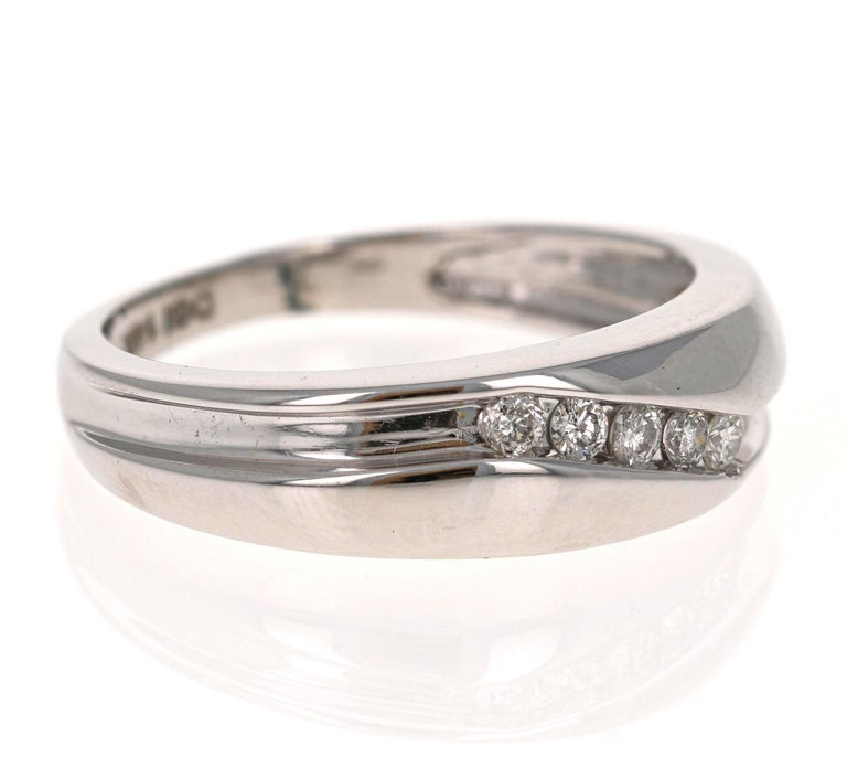We have a Men's Collection of Fine Jewelry!  Beautiful, Bold, Masculine and Simple Men's Wedding Rings/Bands.   This Men's Band has 5 Round Cut Diamonds that weigh 0.25 Carats.  The Clarity and Color of the Diamonds is SI-F.  It is crafted in 14