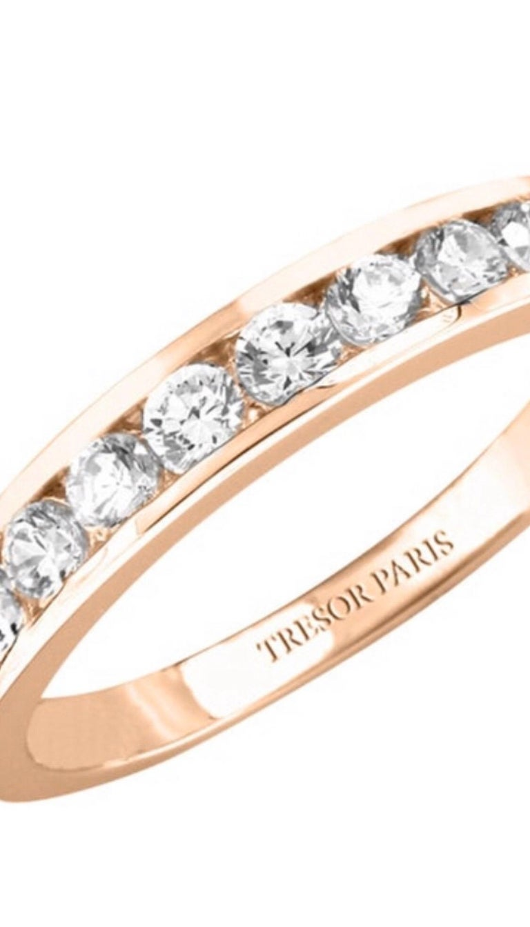 This Channel Set 18 Karat Rose Gold half Eternity ring is an exquisite addition to our collection. A sparkling array of nine H-SI1 Round Brilliant Diamonds for a classic and iconic look. This ring has a total Diamond weight of 0.25 Carats, the