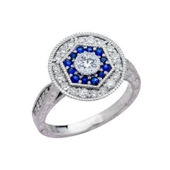 0.25 Carat Round Cut Diamond Antique Ring with Blue Sapphires in 14 Karat Gold