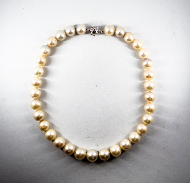 This Necklace is made of 18K White Gold. This Necklace has 0.28 Carats of White Diamonds. This Necklace has 510.00 Carats of Australian Pearls. The Diameter of the Pearls goes from 12.20mm to 14.60mm. We're a workshop so every piece is handmade,