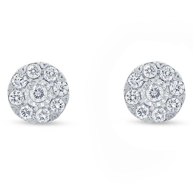 0.28ct 14k White Gold Diamond Cluster Stud Earring   6.00mm Stella Collection   Metal Details Metal Type: 14KWG  Metal Weight: 1.8 GR   Side Diamond Details Carat: 0.29 CT