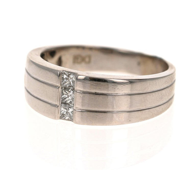 We have a Men's Collection of Fine Jewelry!  Beautiful, Bold, Masculine and Simple Men's Wedding Rings/Bands.   This Men's Band has 3 Princess Cut Diamonds that weigh 0.30 Carats.    It is crafted in 14 Karat White Gold and weighs approximately 7.0