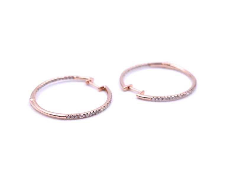 Designer: custom design Material: 14k rose gold Diamonds: 66 round brilliant cut = 0.35 carat weight Color: G Clarity: VS Dimensions: each earring is 25.6mm diameter Fastenings: snap closure Weight: 2.1 grams
