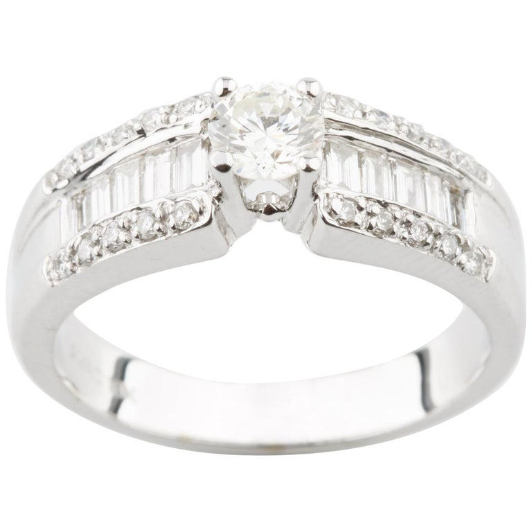 0 37 Carat Round Diamond Solitaire Ring in White Gold with Accents