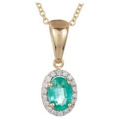 0.39 Carat Oval Emerald White Diamond Halo Pendant 18 Karat Yellow Gold
