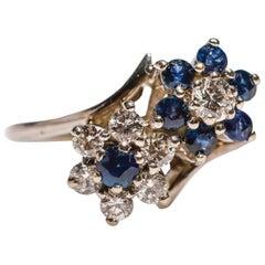 0.40 Carat Blue Sapphire 0.45 Carat Diamond 14 Karat White Gold Floral Ring