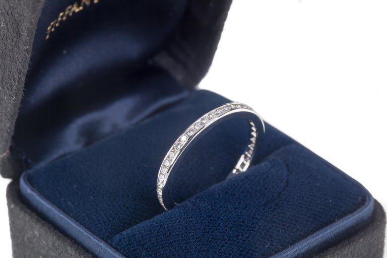 Gorgeous Tiffany & Co. Eternity Band Features Unbroken Row of Channel Set Round Diamonds Total Diamond Weight = 0.40 Cts. Average Color = F Average Clarity = VS1 Size 7 2 mm Wide Includes Original Tiffany & Co. Box Retails for $3600 Total Mass = 3.2