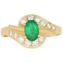 0.42 Carat Oval Emerald and 0.25 Carat White Diamond Ring