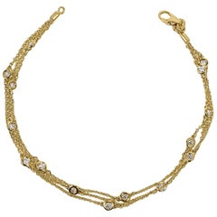 Triple-Row Diamond Station Yellow Gold Bracelet 14 Karat