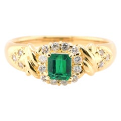 0.44 Carat Natural Emerald and Diamond Ring Set in 18 Karat Yellow Gold