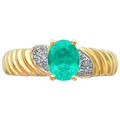 0.44 Carat Oval-Cut Colombian Emerald and Diamond 14 Karat Gold Engagement Ring