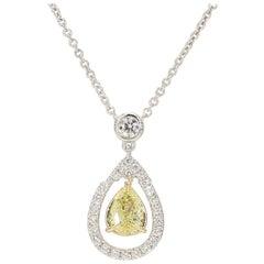 0.44 Carat TW Natural Yellow Diamond Pear Shape White Diamond Halo Pendant